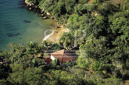 Ilha Grande, Rio de Janeiro State, Brazil. Small unspoilt beach and a holiday house.