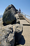 Tourist hiking up stairway path on hiking trail near the top of Moro Rock, Sequoia National Park, California