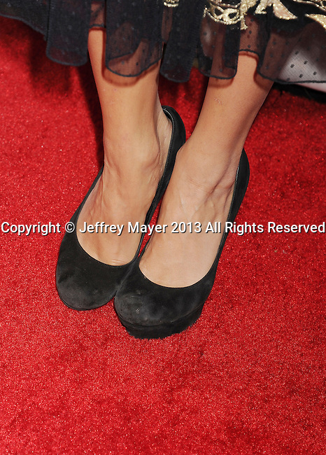 BEVERLY HILLS, CA- AUGUST 15: Actress Vanessa Hudgens (shoe detail) at WWE & E! Entertainment's 'SuperStars For Hope' at the Beverly Hills Hotel on August 15, 2013 in Beverly Hills, California.