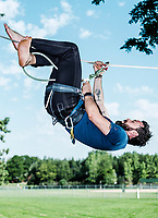 The Adventurist columnist, Clint Carter practices slacklining at Spring Park in Ft. Collins, Colorado, Sunday, August 27, 2017. Carter take on a vertigo-inducing highline that stretches across a traverse after only 4 days of training.<br /> <br /> Photo by Matt Nager