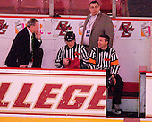 Tom Peters (BC - Senior Associate AD) and Pete Souris join the officials on the BC bench. - The Boston College Eagles defeated the visiting University of Massachusetts-Amherst Minutemen 2-1 in the opening game of their 2012 Hockey East quarterfinal matchup on Friday, March 9, 2012, at Kelley Rink at Conte Forum in Chestnut Hill, Massachusetts.