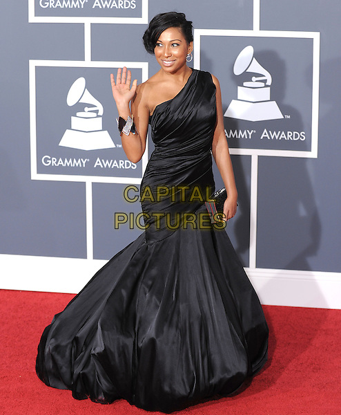 MELONIE FIONA.Arrivals at the 52nd Annual GRAMMY Awards held at The Staples Center in Los Angeles, California, USA..January 31st, 2010.grammys full length black one shoulder fishtail maxi dress hand palm waving .CAP/RKE/DVS.©DVS/RockinExposures/Capital Pictures