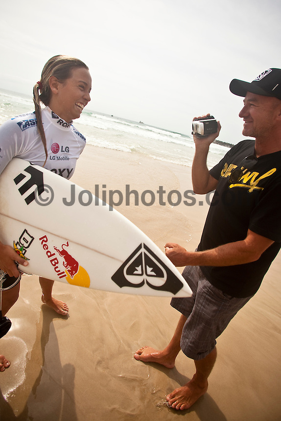 SALLY FITTGIBBONS (AUS)  with here surfboard shaper DARREN HANDLEY (AUS)  after winning her very first heat on the WCT tour...DURANBAH BEACH, Australia (Monday, March 2, 2009) - Day 1 of the Roxy Pro Gold Coast presented by LG Mobile and the new guard of women's surfing announced their intentions with style, punch and bite in clean two-foot (0.75 metre) waves at Duranbah Beach..   Event No. 1 of 8 on the 2009 ASP Women's World Tour, the Roxy Pro Gold Coast opted to relocate from the primary site of Snapper Rocks this morning to Duranbah Beach to take advantage of the conditions on offer, and in addition to the unparalleled dominance of reigning two-time ASP Women's World Champion Stephanie Gilmore (AUS), 21, the 2009 ASP Dream Tour rookies took full advantage of the beachbreak conditions, claiming wins in four of the six Round 1 heats..  Sally Fitzgibbons (AUS), 18, 2009 ASP Women's World Tour rookie, took command in a hard-fought Round 1 heat, scoring the highest heat total of the day with an 18.77 out of a possible 20, to overtake Silvana Lima (BRA), 24, and Megan Abubo (HAW), 31. Lima, current ASP World No. 2, secured the first perfect 10-point ride of the 2009 ASP Women's World Tour season, for a flurry of blistering forehand maneuvers including an incredible mid-wave aerial.  Photo:joliphotos