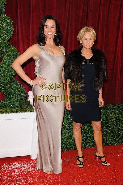 Andrea McLean and Lisa Maxwell.British Soap Awards 2012, The London Television Centre, London, England..28th April 2012.full length black dress hand on hip beige fur jacket.CAP/CJ.©Chris Joseph/Capital Pictures.