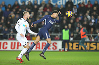 Dele Alli of Spurs under pressure from Mike van der Hoorn of Swansea City during the Premier League match between Swansea City and Tottenham Hotspur at the Liberty Stadium, Swansea, Wales on 2 January 2018. Photo by Mark Hawkins / PRiME Media Images.