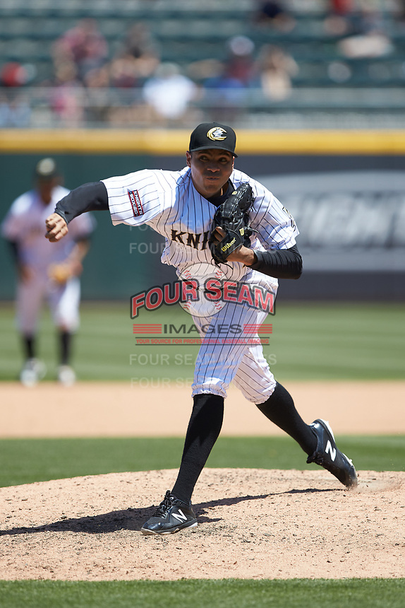 Charlotte Knights relief pitcher Jeanmar Gomez (9) follows through on his delivery against the Gwinnett Stripers at BB&T BallPark on May 2, 2018 in Charlotte, North Carolina.  The Knights defeated the Stripers 6-5.  (Brian Westerholt/Four Seam Images)