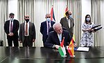 Palestinian Prime Minister Mohammad Ishtayeh, attends the signing of an agreement to support Spain worth 100 million euros via a video link, in the West Bank city of Ramallah, on June 25, 2020. Photo by Prime Minister Office