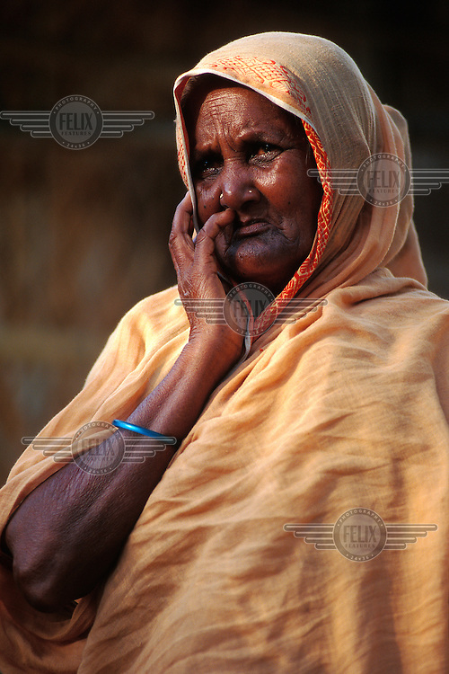 Portrait of an old woman in a poor rice-farming community.