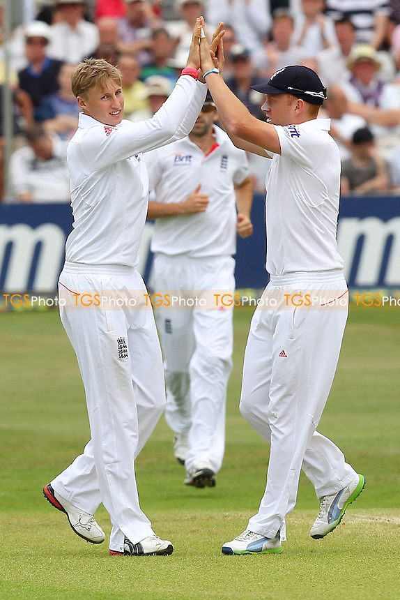 Joe Root of England (L) celebrates the wicket of Owais Shah - Essex CCC vs England - LV Challenge Match at the Essex County Ground, Chelmsford - 01/07/13 - MANDATORY CREDIT: Gavin Ellis/TGSPHOTO - Self billing applies where appropriate - 0845 094 6026 - contact@tgsphoto.co.uk - NO UNPAID USE