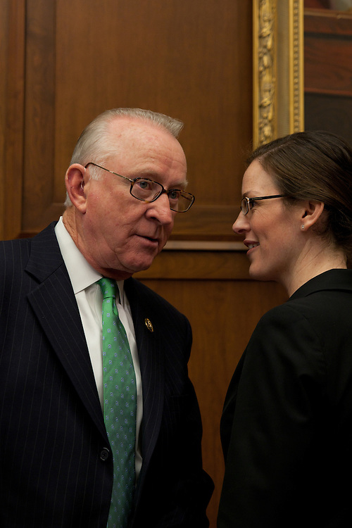 "WASHINGTON, DC - April 29: Ranking member of the House Armed Services Committee, Howard P. ""Buck"" McKeon (R-Calif), talks to a committee staff member prior to a hearing on Pakistan. (Photo by Ryan Kelly/Congressional Quarterly)"