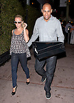 June 19th  2012  tuesday Night ...Kendra Wilkinson & Hank Baskett  posing for the camera after leaving Beso restaurant in Hollywood. Kendra was laughing & smiling wearing big white sunglasses. ....AbilityFilms@yahoo.com.805-427-3519.www.AbilityFilms.com.
