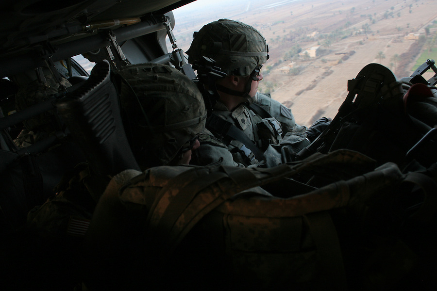 "Soldiers from Headquarters Co. 1-30 Infantry 3rd Infantry Division carry out an ""air assault"" insertion by helicopters as they move into a village south of Baghdad in the Arab Jabour area to inaugurate the creation of a ""concerned local citizen"" presence in a village previously held and used by Sunni insurgents."