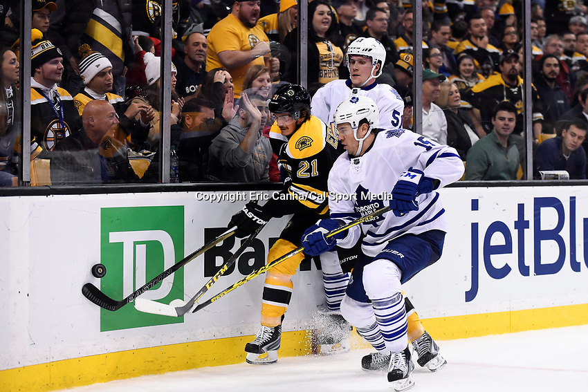 Saturday, November 21, 2015: Boston Bruins left wing Loui Eriksson (21) plays for the puck between Toronto Maple Leafs defenseman Jake Gardiner (51) and right wing P.A. Parenteau (15) during the National Hockey League game between the Toronto Maple Leafs and the Boston Bruins held at TD Garden, in Boston, Massachusetts. The Bruins defeat the Maple Leafs 2-0 in regulation time. Eric Canha/CSM