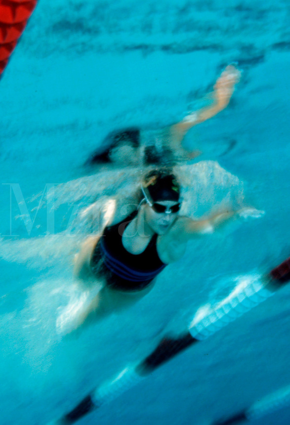Underwater view of a female swimmer training during swimming practice.