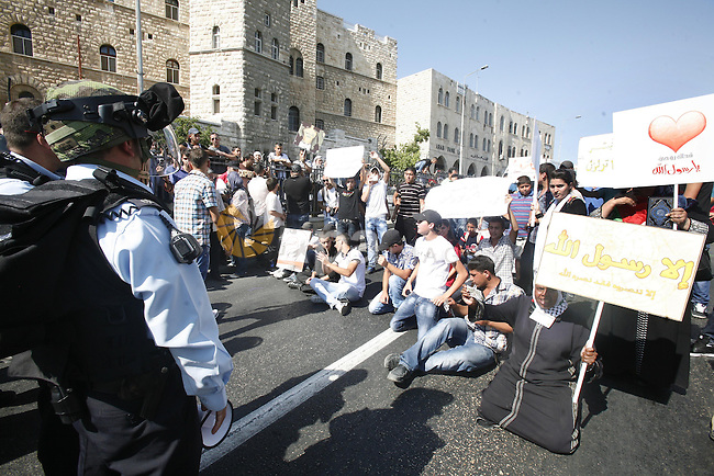 Israeli policemen repress a demonstration against the controversial film 'Innocence of Muslims' in front of al-Aqsa Mosqe in Jerusalem, on September 14, 2012. The controversial low budget film reportedly made by an Israeli-American which portrays Muslims as immoral and gratuitous, sparked fury in Libya, where four Americans including the ambassador were killed on Tuesday when a mob attacked the US consulate in Benghazi, and has led to protests outside US missions in Morocco, Sudan, Egypt, Tunisia and Yemen. Photo by Mahfouz Abu Turk