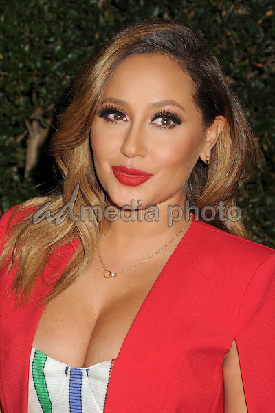 "9 December 2015 - Los Angeles, California - Adrienne Bailon. Opening Night of ""Kurios"" from Cirque du Soleil held at Dodgers Stadium. Photo Credit: Byron Purvis/AdMedia"