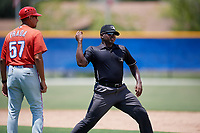 GCL Phillies West manager Nelson Prada (57) is ejected by umpire Tre Jester during a game against the GCL Blue Jays on August 7, 2018 at Bobby Mattick Complex in Dunedin, Florida.  GCL Blue Jays defeated GCL Phillies West 11-5.  (Mike Janes/Four Seam Images)