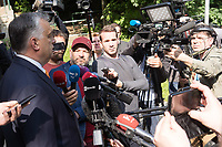 Hungarian Prime Minister Viktor Orban talks to members of the media after he cast his vote during the European Parliamentary election in Budapest, Hungary on May 26, 2019. ATTILA VOLGYI