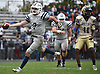 Charlie McKee #7, Oceanside freshman quarterback, carries into the end zone for a touchdown in the second quarter of a Nassau County Conference I varsity football game against host Baldwin High School on Saturday, Oct. 6, 2018. Oceanside won by a score of 35-0.