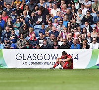 Wales's Adam Thomas looks dejected at the final whistle<br /> <br /> Australia Vs Wales - Men's quarter-final<br /> <br /> Photographer Chris Vaughan/CameraSport<br /> <br /> 20th Commonwealth Games - Day 4 - Sunday 27th July 2014 - Rugby Sevens - Ibrox Stadium - Glasgow - UK<br /> <br /> © CameraSport - 43 Linden Ave. Countesthorpe. Leicester. England. LE8 5PG - Tel: +44 (0) 116 277 4147 - admin@camerasport.com - www.camerasport.com