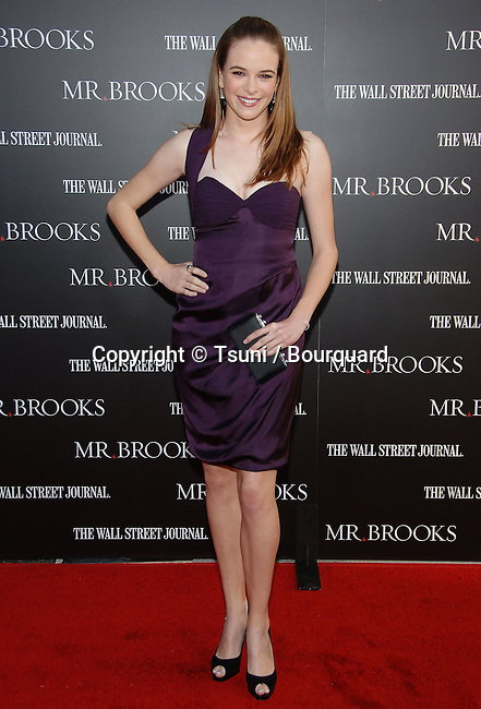 Danielle Panabaker arriving at Mr BROOKS Premiere at the Chinese  Theatre In Los Angeles. <br /> <br /> full length<br /> eye contact<br /> smile<br /> purple dress