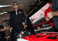 Mar 29, 2014; Las Vegas, NV, USA; NHRA top fuel driver Steve Torrence gets into his car to warm it up during qualifying for the Summitracing.com Nationals at The Strip at Las Vegas Motor Speedway. Mandatory Credit: Mark J. Rebilas-
