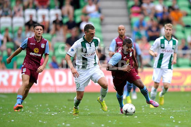 GRONINGEN - Voetbal, FC Groningen - Aston Villa, voorbereiding seizoen 2014-2015, 02-08-2014,  FC Groningen speler Yoell van Nieff  met Leando Bacuna