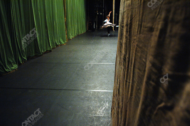 Nelli Kobakhidze warmed up in the minutes before the curtain went up for Massine's Le Tricorne at the Bolshoi Theatre's New Stage in which she was dancing the lead role. Moscow, Russia, January 25, 2007
