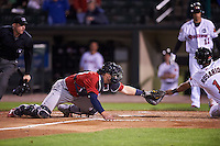 Columbus Clippers catcher Adam Moore (25) swipes the tag at Eddie Rosario (1) scoring the game winning run as umpire Joe Born looks on to make the call during a game against the Rochester Red Wings on June 14, 2016 at Frontier Field in Rochester, New York.  Rochester defeated Columbus 1-0.  (Mike Janes/Four Seam Images)