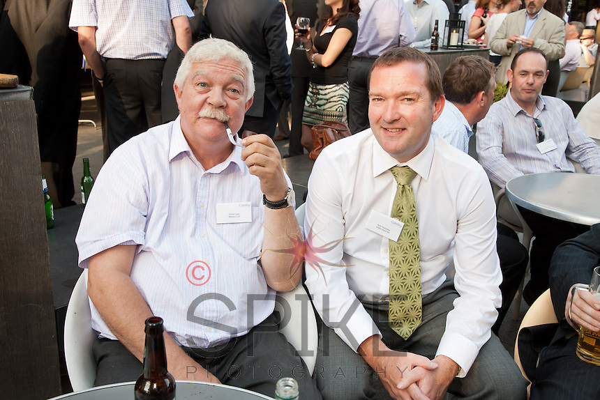 Philip Lyon of Mazars poses with his pipe along with HSBC's Nick Holloway