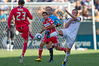 Chris Birchall of the LA Galaxy battles Chicago Fire's Krzysztof Krol. The Chicago Fire beat the LA Galaxy 3-2 at Home Depot Center stadium in Carson, California on Sunday August 1, 2010.