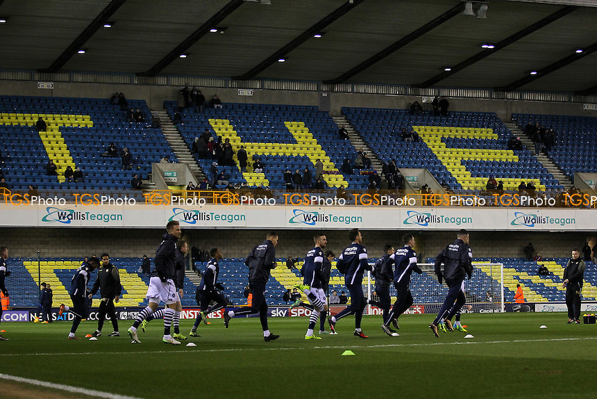 Millwall players warm up before the match during Millwall vs Oxford United at The Den
