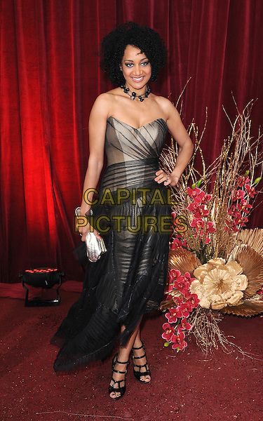 TUPELE DORGU.Arrivals at the British Soap Awards 2010, London Television Centre, London, England..May 8th, 2010.full length strapless black tulle dress hand on hip beige cut out strappy shoes sandals .CAP/BEL.©Tom Belcher/Capital Pictures.