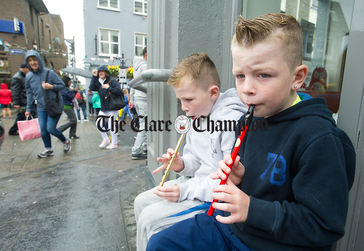 Local brothers Patrick and Thomas Sherlock, aged 8 and 7, playing o the street, during Fleadh Cheoil na hEireann in Ennis. Photograph by John Kelly.