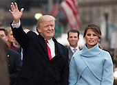 United States President Donald Trump and First Lady Melania Trump walk in their inaugural parade after being sworn-in as the 45th President in Washington, D.C. on January 20, 2017.    <br /> Credit: Kevin Dietsch / Pool via CNP