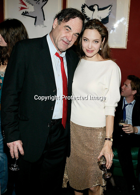 Oliver Stone and Angelina Jolie