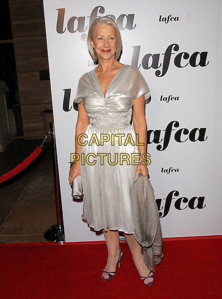 HELEN MIRREN.attends The 32nd Annual Los Angeles Film Critics Association Awards (LAFCA) held at The InterContinental Los Angeles in Century City, California, USA, .January 14 th 2007..full length pale grey silver dress clutch bag shawl pasmina wrap dame .CAP/DVS.©Debbie VanStory/Capital Pictures