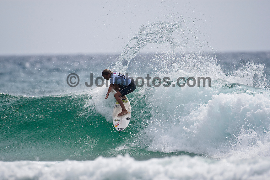 SALLY FITZGIBBON (AUS)       .  DURANBAH BEACH, Australia (Monday, March 2, 2009) - Day 1 of the Roxy Pro Gold Coast presented by LG Mobile and the new guard of women's surfing announced their intentions with style, punch and bite in clean two-foot (0.75 metre) waves at Duranbah Beach..   Event No. 1 of 8 on the 2009 ASP Women's World Tour, the Roxy Pro Gold Coast opted to relocate from the primary site of Snapper Rocks this morning to Duranbah Beach to take advantage of the conditions on offer, and in addition to the unparalleled dominance of reigning two-time ASP Women's World Champion Stephanie Gilmore (AUS), 21, the 2009 ASP Dream Tour rookies took full advantage of the beachbreak conditions, claiming wins in four of the six Round 1 heats..  Sally Fitzgibbons (AUS), 18, 2009 ASP Women's World Tour rookie, took command in a hard-fought Round 1 heat, scoring the highest heat total of the day with an 18.77 out of a possible 20, to overtake Silvana Lima (BRA), 24, and Megan Abubo (HAW), 31. Lima, current ASP World No. 2, secured the first perfect 10-point ride of the 2009 ASP Women's World Tour season, for a flurry of blistering forehand maneuvers including an incredible mid-wave aerial.  Photo:joliphotos