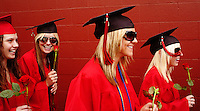 Mt. Baker High School students, from left, Lindsay Noble, 18, Anne Travers, 18, Johanna Norstadt, 17, and Kyla Melendy, 18, begin their graduation ceremony with a procession to the football field.