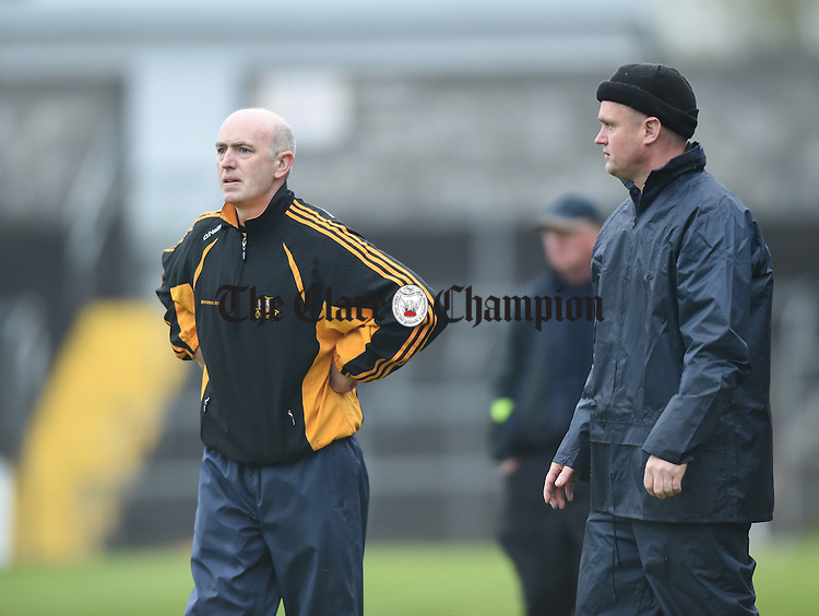 Ballyea manager Robbie Hogan and selector Raymond O Connor on the sideline during their match in Ennis. Photograph by John Kelly.