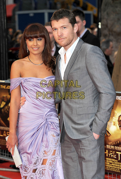 "NATALIE MARK & SAM WORTHINGTON.The World Premiere of ""Clash Of The Titans"", Empire Leicester Square, London, England..29th March 2010.half length stubble facial hair fringe couple lilac purple off the shoulders strapless grey gray suit white shirt dress silk satin ruched arm around hand in pocket clutch bag lace cut out silver sparkly.CAP/BEL.©Tom Belcher/Capital Pictures."