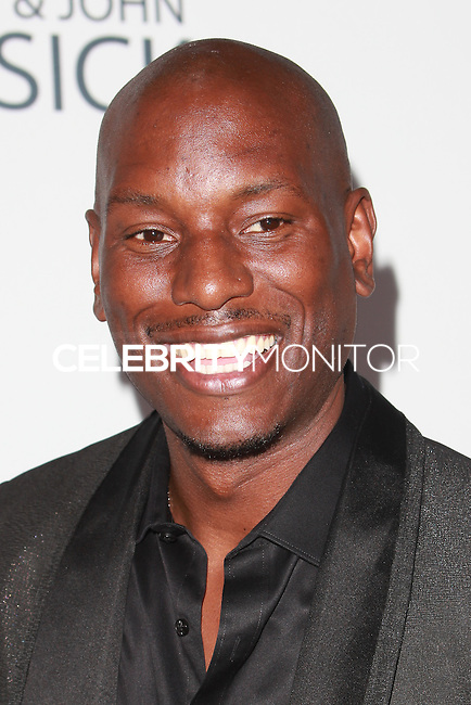 UNIVERSAL CITY, CA, USA - SEPTEMBER 30: Tyrese Gibson arrives at LA's Promise Gala 2014 held at the Globe Theatre at Universal Studios on September 30, 2014 in Universal City, California, United States. (Photo by David Acosta/Celebrity Monitor)