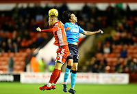 Markus Schwabl of Fleetwood Town battles the head challenge with Kieron Morris of Walsall during the Sky Bet League 1 match between Walsall and Fleetwood Town at the Banks's Stadium, Walsall, England on 21 November 2017. Photo by Leila Coker.