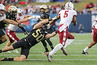 Annapolis, MD - December 27, 2016: Wake Forest Demon Deacons linebacker Grant Dawson (50) gets stiff armed by Temple Owls running back Jahad Thomas (5) during game between Temple and Wake Forest at  Navy-Marine Corps Memorial Stadium in Annapolis, MD.   (Photo by Elliott Brown/Media Images International)