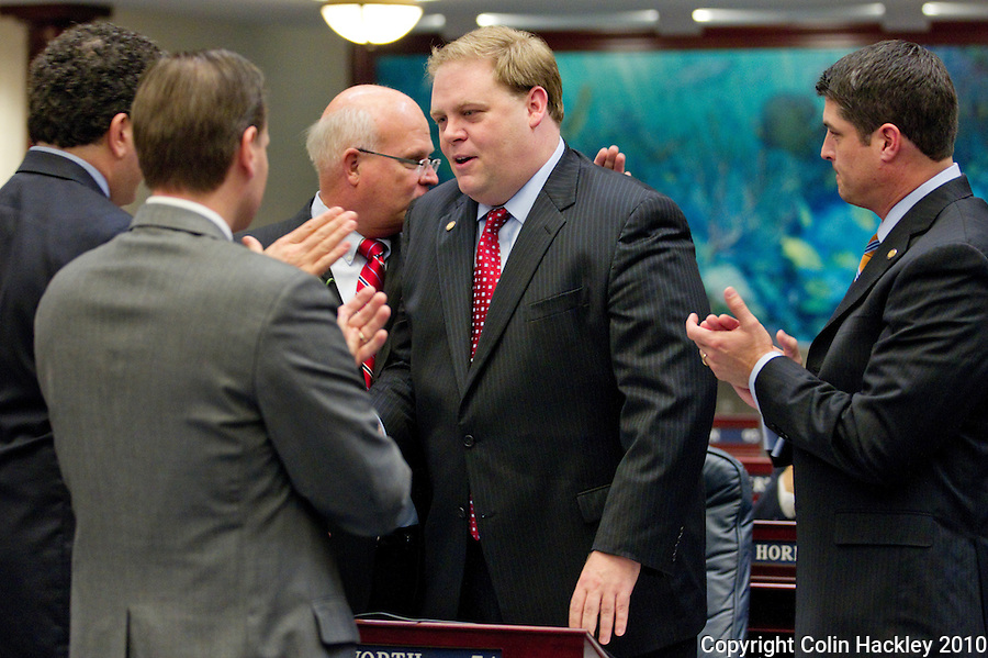 TALLAHASSEE, FLA. 11/16/10-SPEC.SESS111610HACKLEY06-Rep. Chris Dorworth, R-Lake Mary, center is congratulated after the veto override on his rules bill passes the House during Special Session of the Legislature Tuesday at the Capitol in Tallahassee...COLIN HACKLEY PHOTO