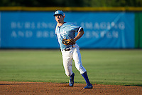 Burlington Royals second baseman Brian Bien (3) makes a throw to first base against the Danville Braves at Burlington Athletic Park on August 13, 2015 in Burlington, North Carolina.  The Braves defeated the Royals 6-3. (Brian Westerholt/Four Seam Images)