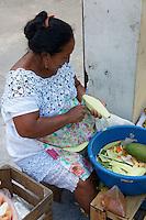 Maya woman peeling vegetables in Merida, Yucatan, Mexico.