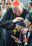 Cardinal Timothy Dolan, the archbishop of New York, embraces Aseat Anwaiya as he enters the church in Inishke, Iraq, on April 10, 2016. Dolan, chair of the Catholic Near East Welfare Association, is in Iraqi Kurdistan with other church leaders to visit with Christians and others displaced by ISIS. They celebrated Mass in the Chaldean Catholic church with local residents and displaced Christians living in local villages.<br /> <br /> CNEWA is a papal agency providing humanitarian and pastoral support to the church and people in the region.