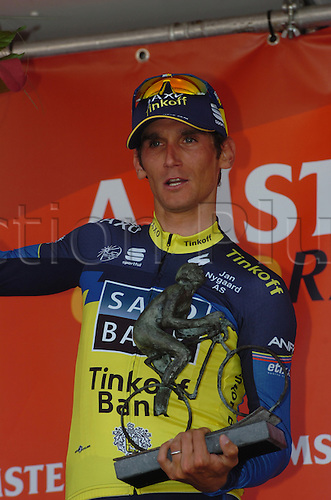 14.04.2013 Valkenburg, Holland. Roman Kreuziger wins the Amstel Gold Race in the Limburg province of the Netherlands. Pictured on the podium