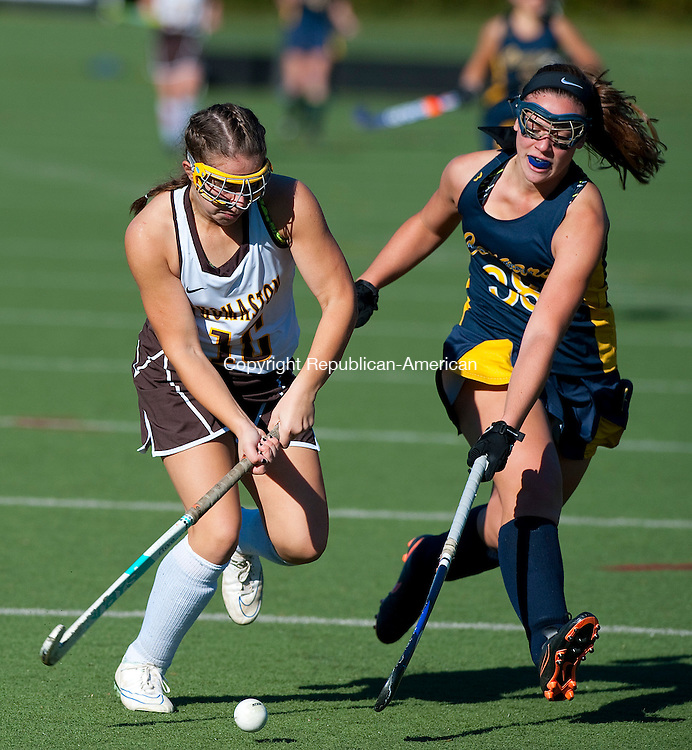 WETHERSFIELD, CT--- -112115JS04--Thomaston's Alexa Milius (16) tries to get past Haddam-Killingworth's Cassie Harlow (38) during their Class S state finals game Saturday at Wethersfield High School.<br /> Jim Shannon Republican-American